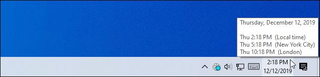 Passer la souris sur l'horloge de la barre des tâches pour obtenir des informations supplémentaires sur le fuseau horaire.