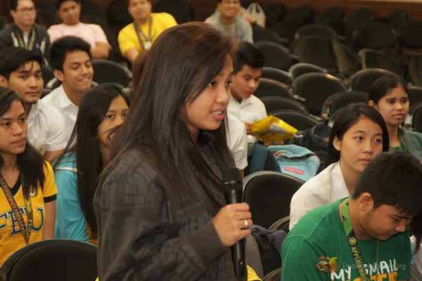 A student asking a question to the speakers