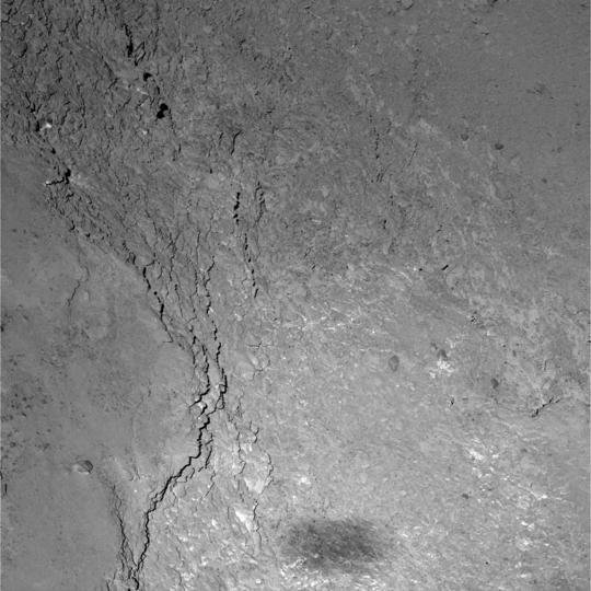 Close-up view of the Imhotep region on comet 67P/Churyumov-Gerasimenko caught by OSIRIS' Narrow Angle Camera during Rosetta's flyby on 14 February 2015. Only six kilometers separate Rosetta from the comet's surface leading to a resolution of 11 centimeters per pixel. At the bottom of the image Rosetta's shadow can be seen.  <br /></dt><dd class=