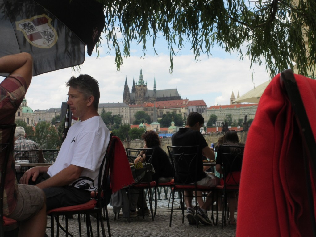 A cafe in Prague, with Prague Castle in the background