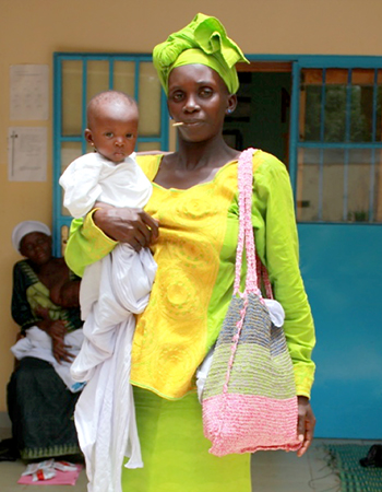 A mother preparing for discharge with her baby who has completed nutritional recovery