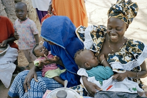 Gambian mother in Keneba breastfeeding her infant