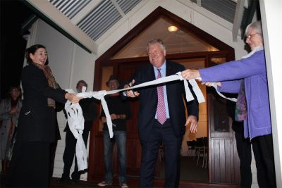 Barry House cutting ribbon at church reopening