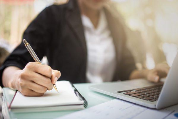 teacher working on laptop