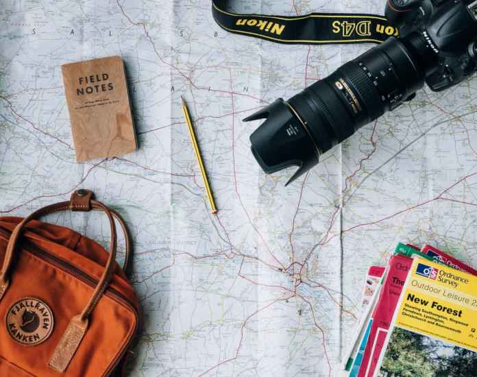 Do We Really Need Travel Insurance - Map and Camera