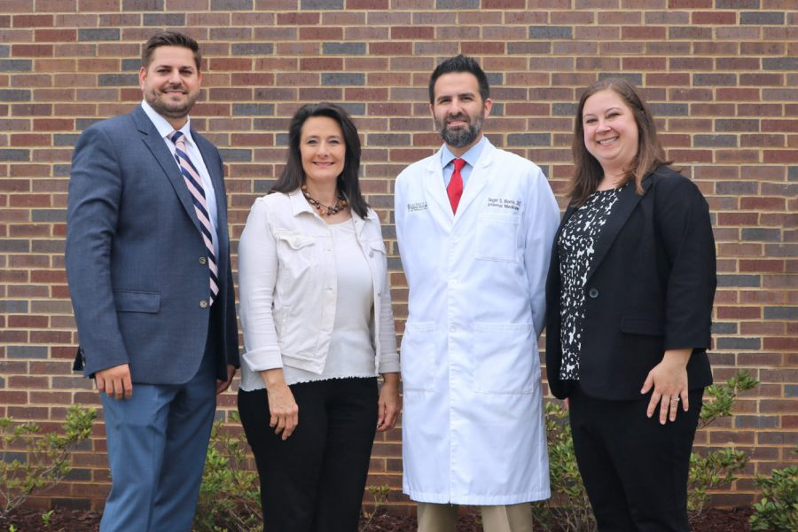 Dr. Peyton Preece, Associate Program Director; Gena Lindsey, Designated Institutional Officer; Dr. Seger Morris, Director of Magnolia Regional Community Care Clinic; Dr. Hayes Baker, Internal Medicine Program Director.