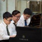 Three students having fun playing piano at Musicthon 2020