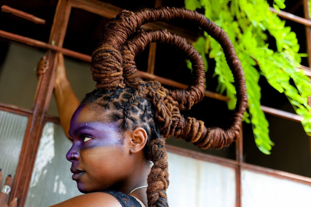 Woman with dreads styled in a crown