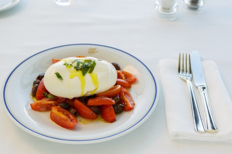 Fresh Burrata in Foglia with Cherry Tomatoes and Taggiasche Olives