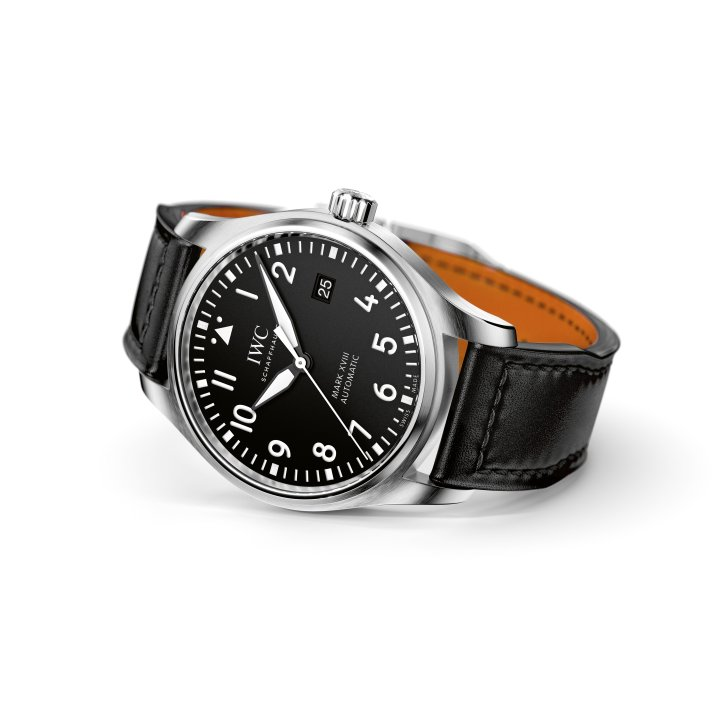 HANDOUT – The Pilot's Watch Mark XVIII (Ref. IW327001) from IWC Schaffhausen features a case in stainless-steel, black dial and black calfskin strap by Santoni with a stainless-steel pin buckle. Engraved into the reverse side of the watch is a depiction of a Ju 52. (PHOTOPRESS/IWC)