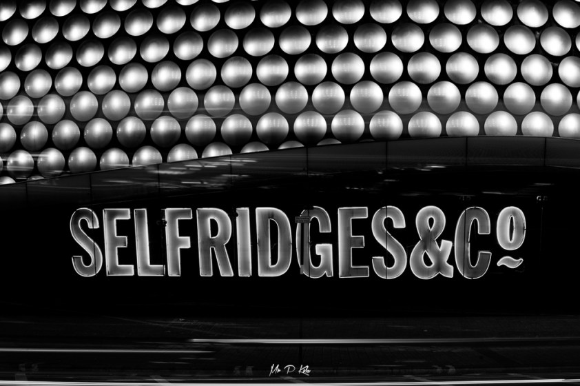 Black and white image of the Selfridges & Co. signage on the Bullring Shopping centre store in Birmingham