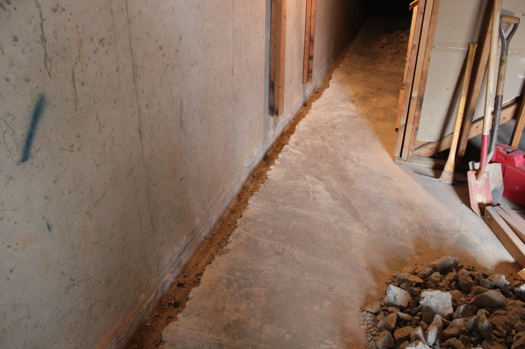 make slope in basement to stop water