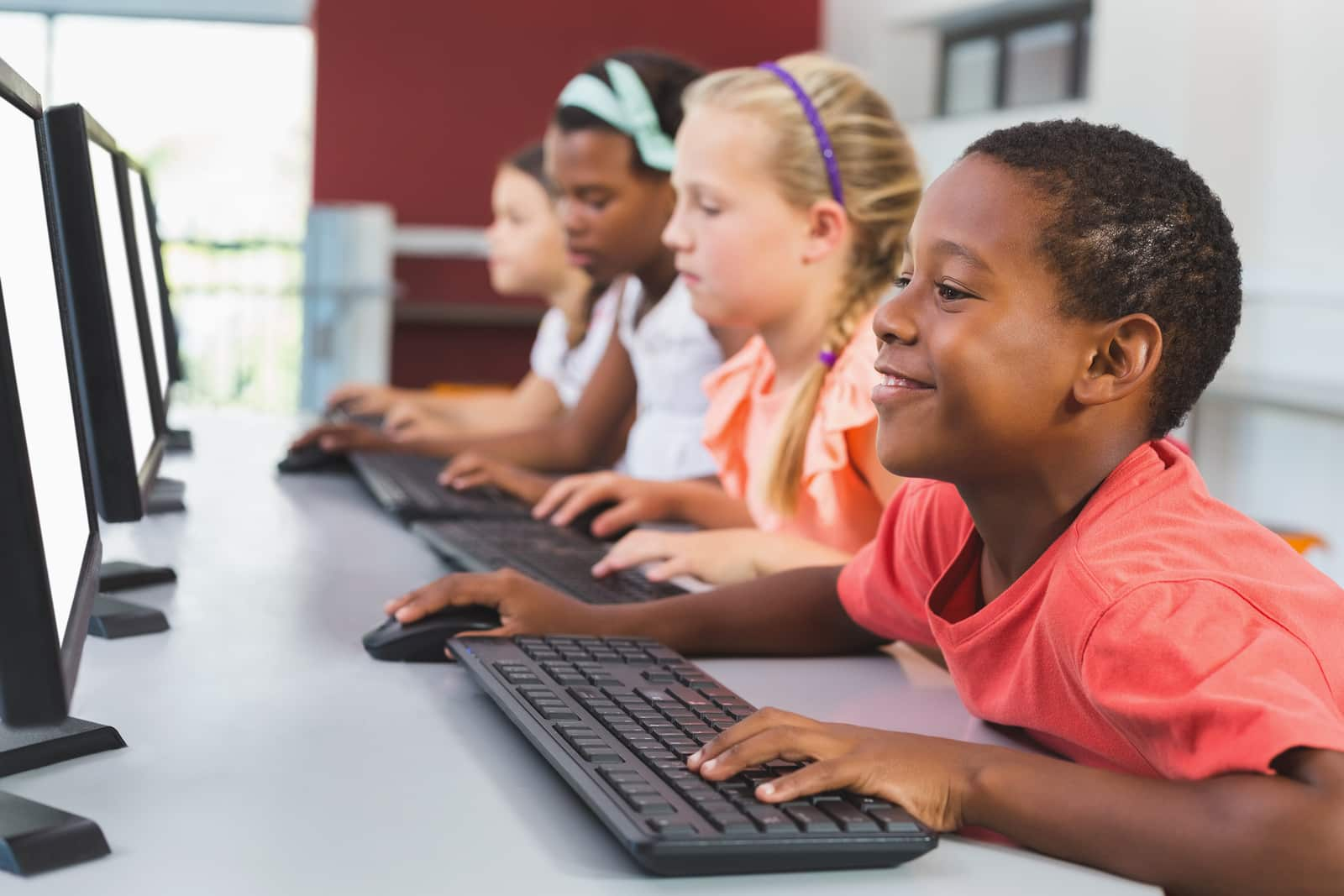 School kids using computer in classroom at school