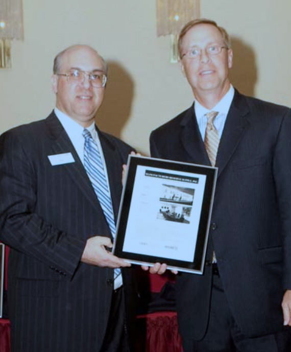 NJBIA President Philip Kirschner (left) presents an NJBIA New Good Neighbor Award to Steve Boyd (right), President of MRS during NJBIA's 49th Annual New Good Neighbor Awards Luncheon.