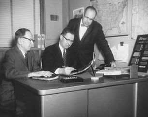 1953 - Left to right - Roy McClean, Sales Manager and Robert A. Boyd, Jr., President reviewing new marketing strategy.