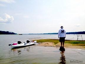 Image of man and kayak on island
