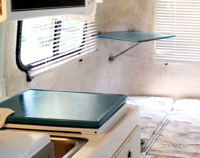 Teal Painted TV Stand and Range Top in a Casita Travel Trailer