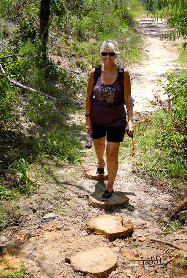 Woman hiking Bastrop State Park's Red Trail