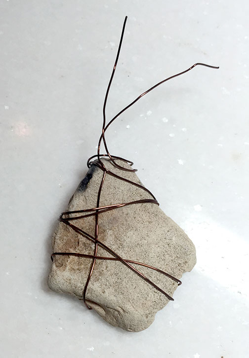 Attaching a leaf charm with wire to rock