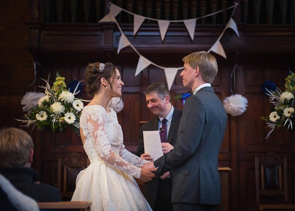 winter wedding, church wedding, julie anne images, anglo dutch wedding , church hall reception, dutch decor, bride and groom at altar, wedding ceremony