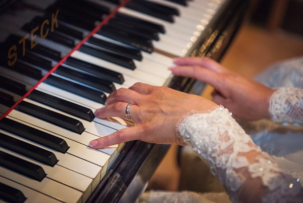 winter wedding, church wedding, julie anne images, anglo dutch wedding , church hall reception, dutch decor, bride playing piano