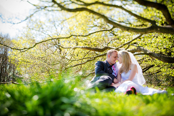 Emma & Dan, woodland photography, bride and groom sitting in clearing,  Neil Redfern photography
