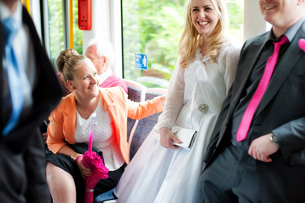 Emma & Dan wedding, Neil Redfern photography, bride and groom and guest on manchester tram