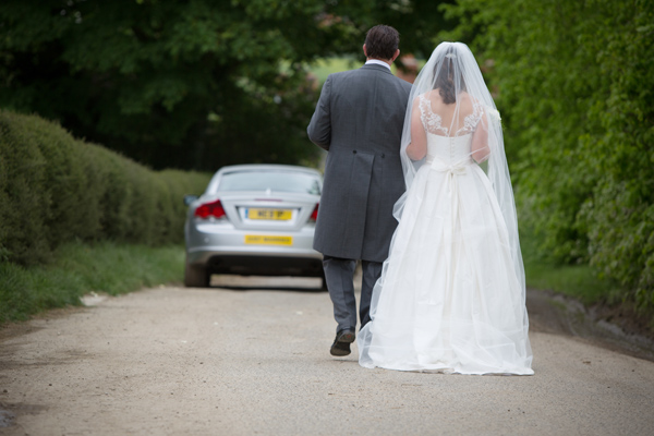 Hayley Ruth Photography, walking bride and groom, country road