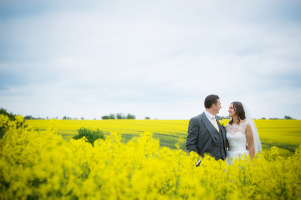 Hayley Ruth Photography, bride and groom, field of yellow flowers