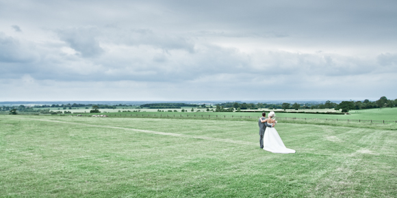 mark pugh photography, bride and groom in field