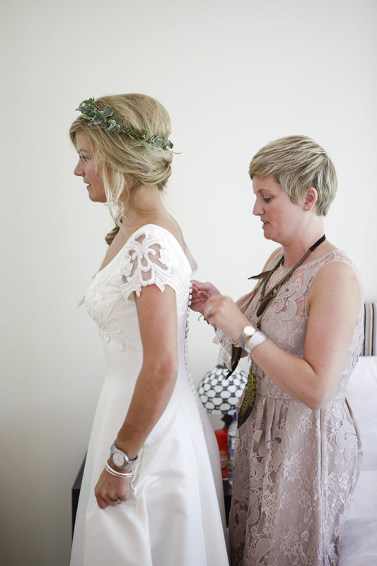 bride getting in dress, dragonfly dress design, ivy hair crown, silver photography