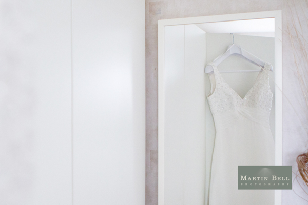 wedding dress hanging up, Winchester wedding photography, Martin Bell Photography
