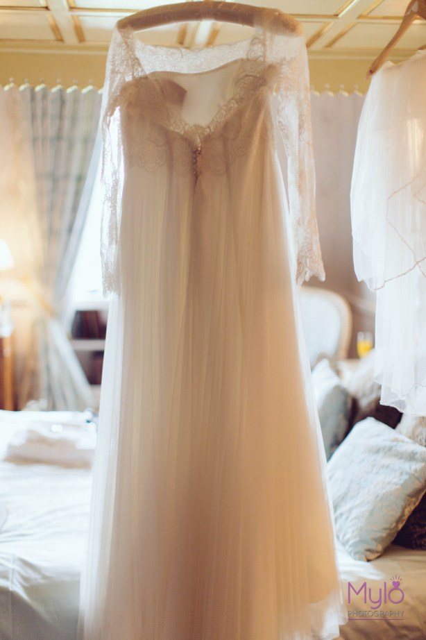 wedding dress hanging up, raimon bundo wedding dress, mylo photography