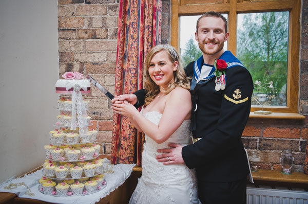 Cloud9-Wedding-Photography, bride and groom, cutting cake, cardlington village hall