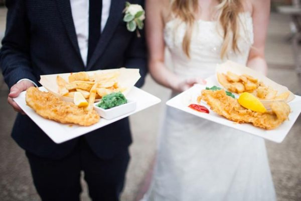 NavyBlur photography, bride and groom with fish and chips, blogging bride