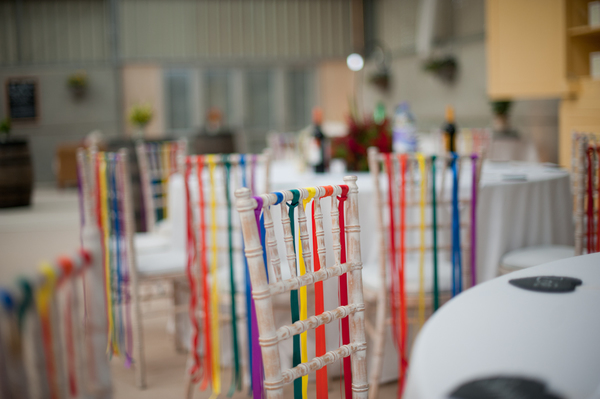 © jamie penfold photography 2015 - www.memoriesandemotions.co.uk, rainbow wedding, diy wedding, colourful ribbon chair back decoration