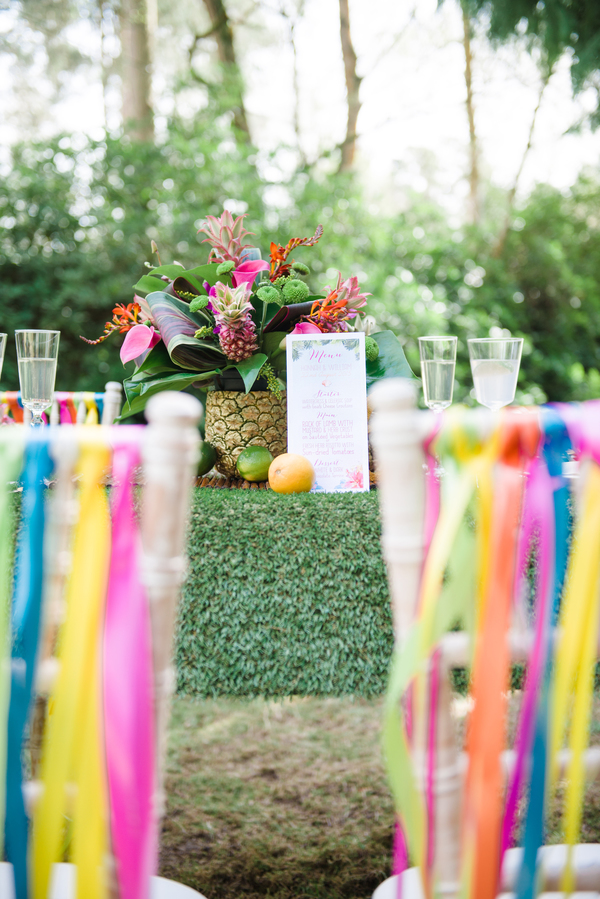 tropical wedding, tropical wedding styled shoot, hannah mcclune photo, stoke place, tropical centrepiece, rainbow chair back ribbons