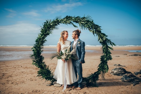 A stunning intimate beach elopement styled shoot with ocean blues and textured details