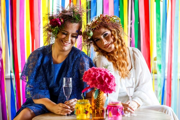 A colourful same sex festival theme wedding shoot with a boho vibe