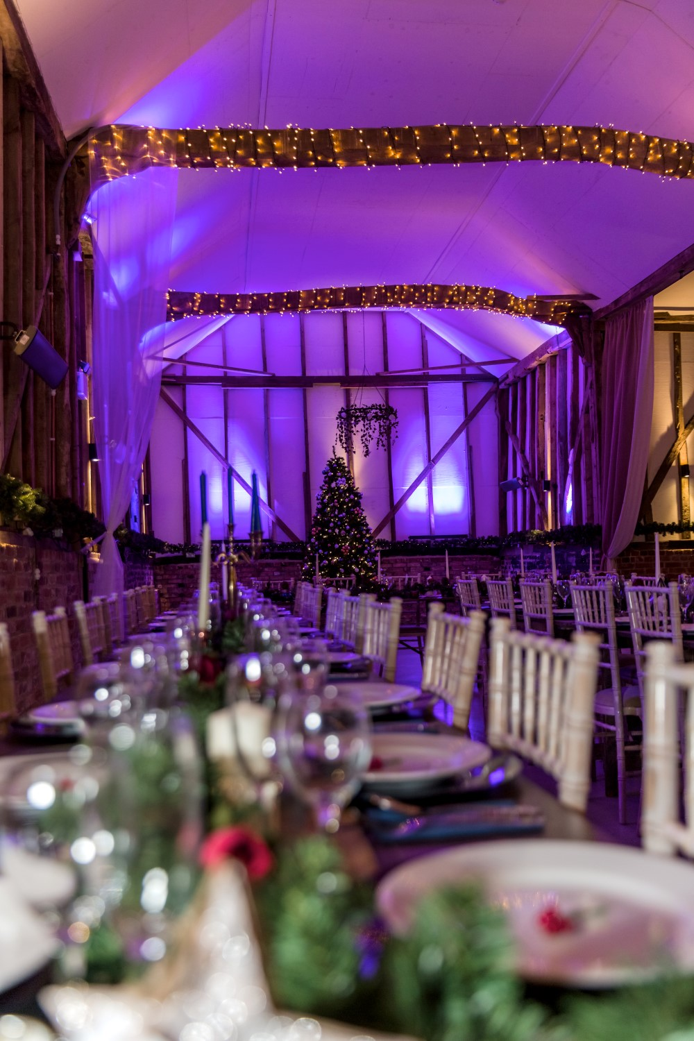 winter wedding - wedding tablescape - wedding reception set up - purple lighting