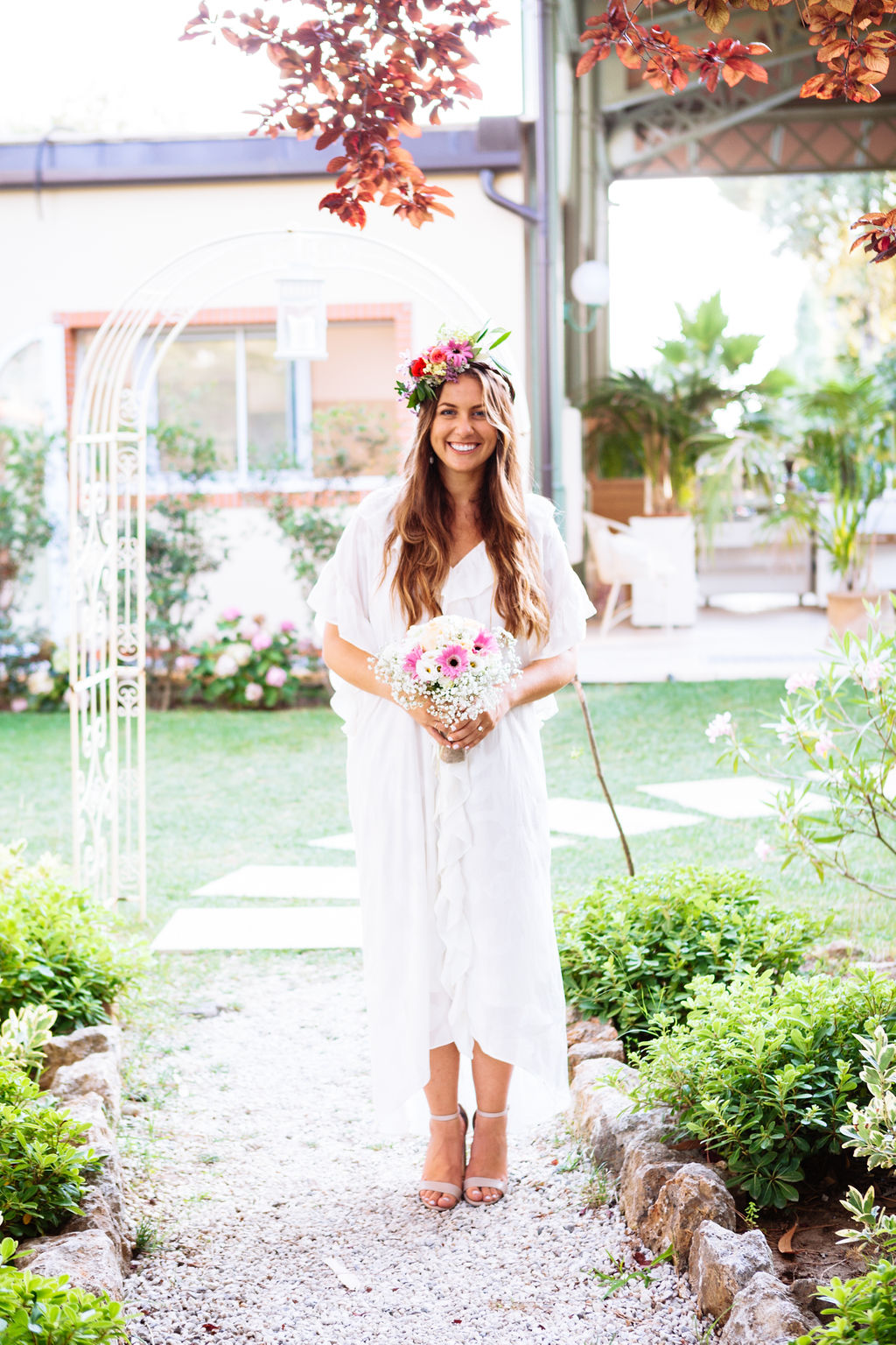 intimate wedding in Tuscany - Elizabeth Armitage Photography - bride with bouquet and floral crown