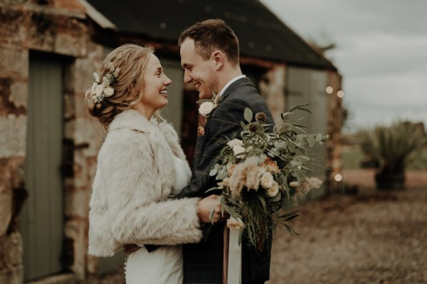 A stunning rustic Fife Micro wedding with pretty peach details at The Cow Shed Crail