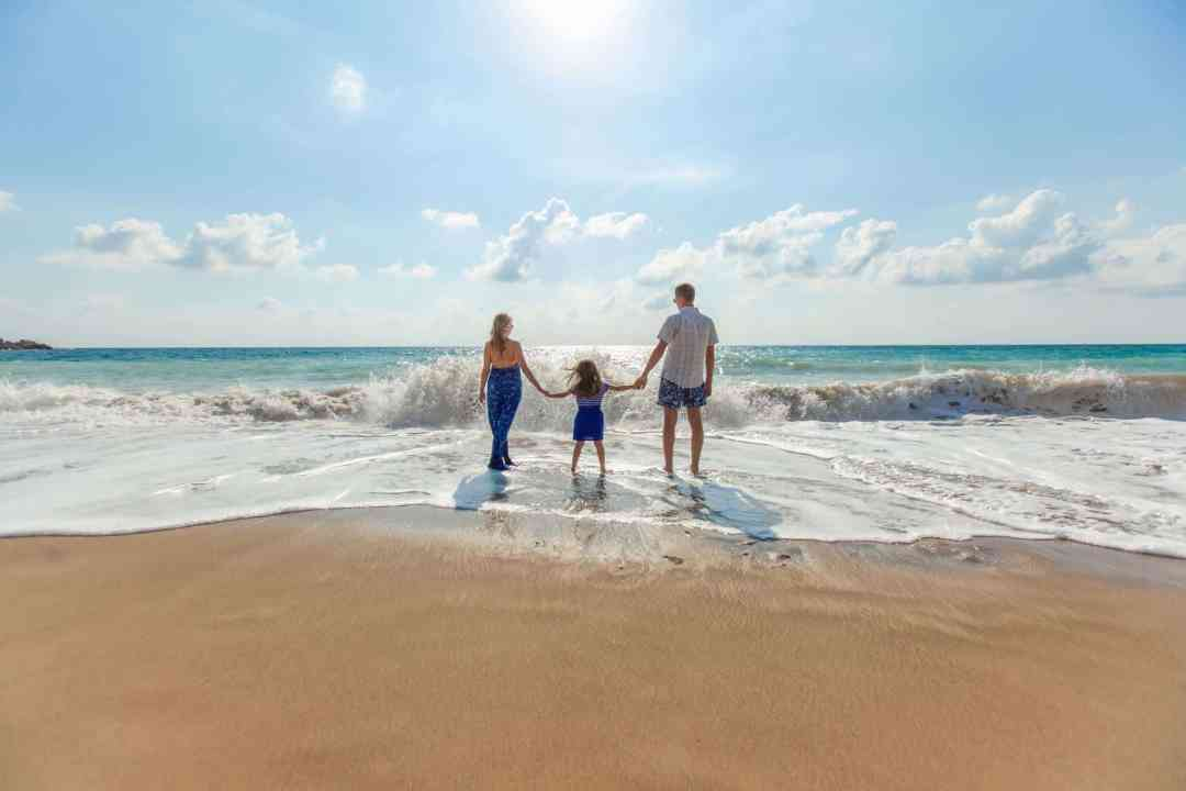 family travel on beach