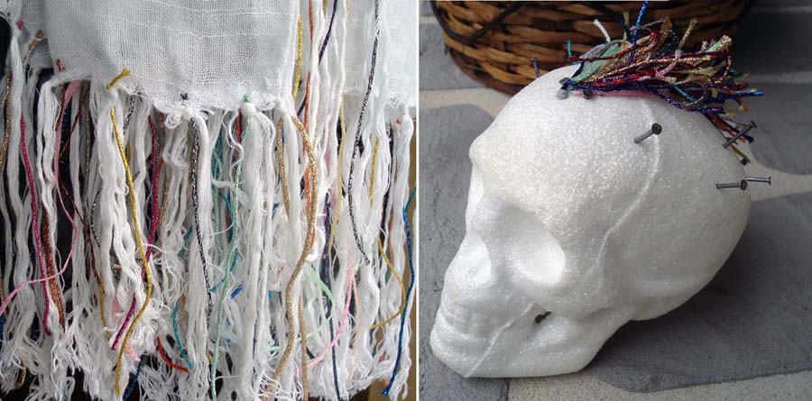 Upcycling even the least expensive things by the addition of colorful fibers: metallic thread bits add visual interest to plain fringe on a purchased scarf, or crazy hair on a styrofoam skull.