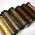 Spools of metallic threads