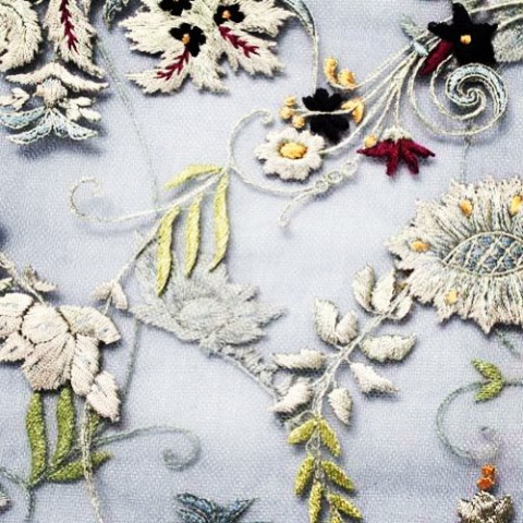 A close up of the embroidery