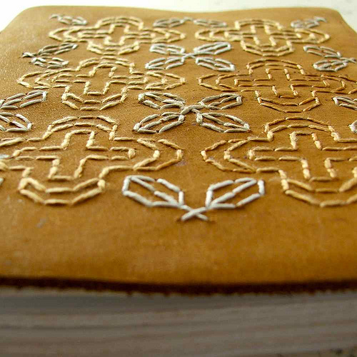 Blackwork embroidery on leather journal by Smallest Forest