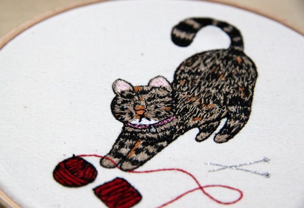 Knitty Kitty by Leigh Bowser. Machine embroidery.