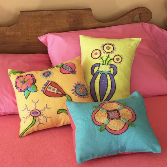 Kristen Nicholas - Crewel Pillows on Bed