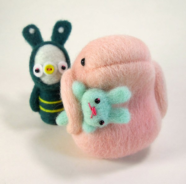 He Brought Him Home for Breakfast. Needle felted wool sculpture by Kit Lane.